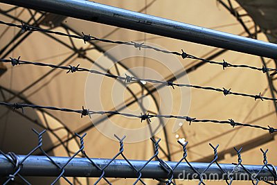 Keep Out! Secure enclosure with barbed wire fence