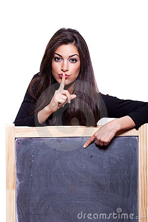 Keep it secret. Woman pointing at blackboard