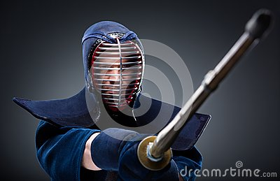 Kendo fighter with bamboo sword