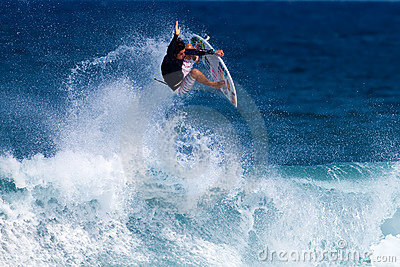 Keoni Jones Surfing at Rocky Point in Hawaii Editorial Photo