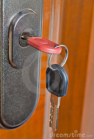 Free Key In The Door Lock Stock Image - 23960891
