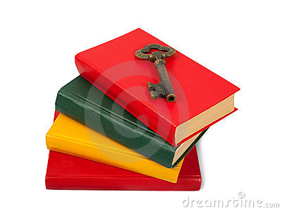 Key placed on pile of books
