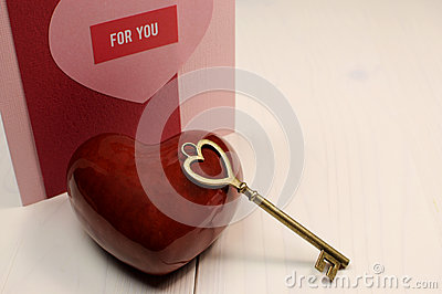 Key to My Heart  love concept, with gold heart shape key and red heart
