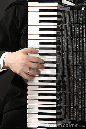 The keyboard of an accordion with a hand