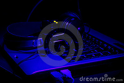 Keyboard and headphones in ultra-violet rays