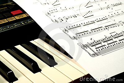 Keyboard with a sheet of music