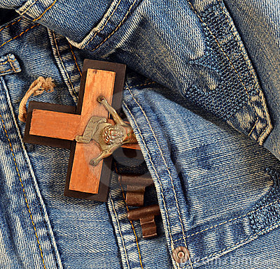 Keys, cross in jeans pocket