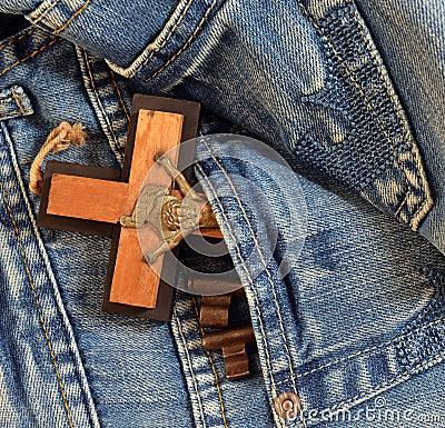 Keys, cross in jeans pocket