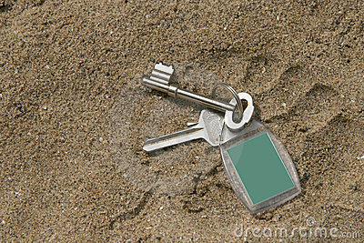 Keys dropped on sand