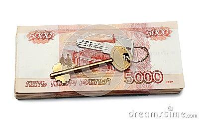 Keys of dwelling on money stack