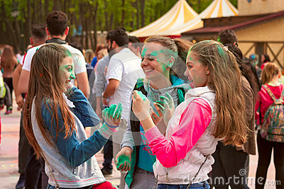 Kharkiv, Ukraine - April 24, 2016. Group of happy girls on holi festival Editorial Stock Image