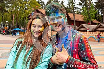 Kharkiv, Ukraine - April 24, 2016. Portrait of happy couple in love on holi festival Editorial Stock Photo