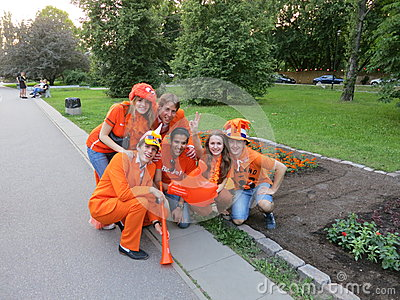 KHARKIV, UKRAINE - JUNE 2012: Dutch football supporers dressed in the national colour Orange. The fans are supporting the national