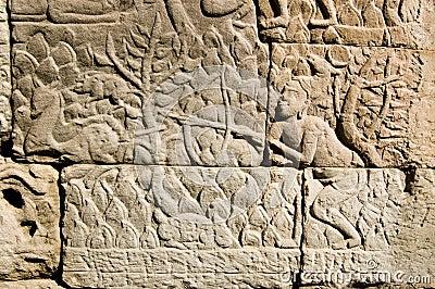 Khmer antico che intaglia il cacciatore dei cervi