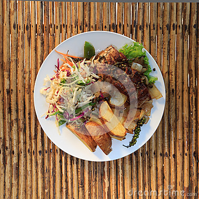 Free Khmer Barracuda Steak With Vegetable Salad Royalty Free Stock Photo - 51427965