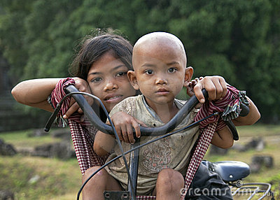 Khmer children on a bycycle Editorial Photography