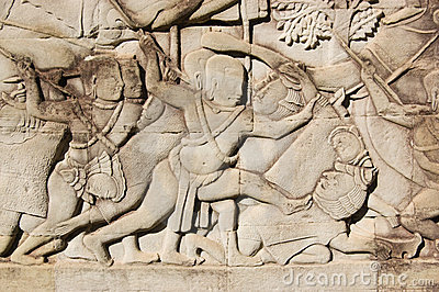 Khmer soldier killing Cham warrior carving