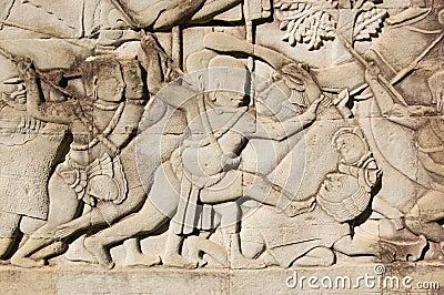 Khmer soldier killing Cham warrior carving