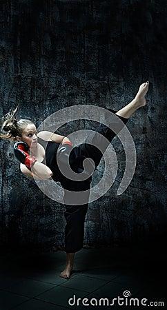 Kick boxer woman wearing boxing gloves