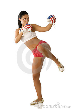Cute brunette with boxing gloves starting to kick.