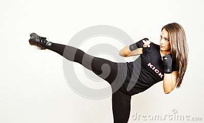 Kick boxing young woman