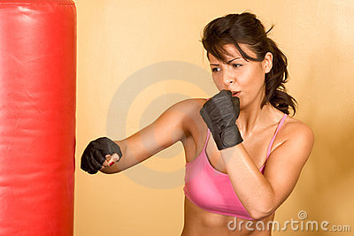 Kickboxing training, woman in kicking Punching Bag
