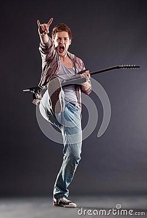 Kicking guitarist