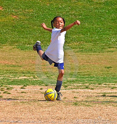 Free Kicking The Ball / Girl S Soccer Stock Image - 14208871