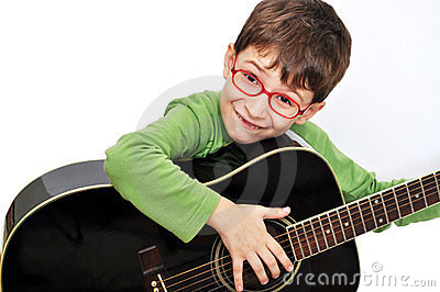 Kid with acoustic guitar