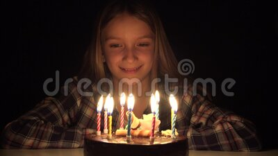 Kid Birthday Party Blowing Candles in Night, Child Celebration, Teenager Girl Anniversary in Dark.  stock video footage