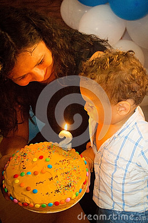 Free Kid Blowing Candles On Birthday Cake. Stock Images - 44275534