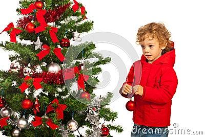 Kid boy decorate tree