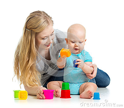 Kid boy and mother playing together with toys