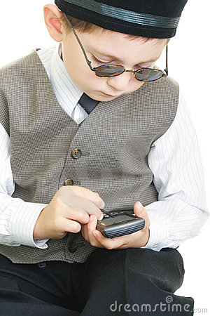 Kid busy with palm computer and stylus