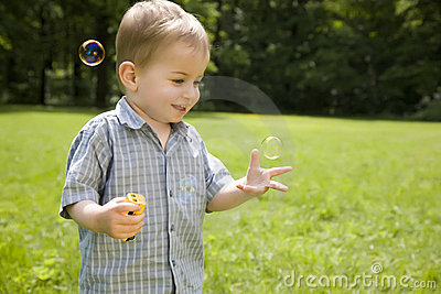 Kid Catches Soap Bubbles