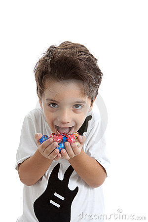 Kid with chocolate eggs on his hands