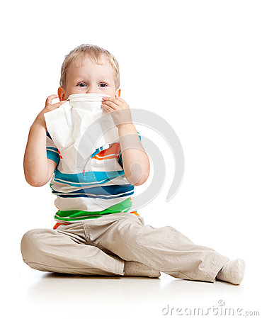 Kid cleaning nose with tissue