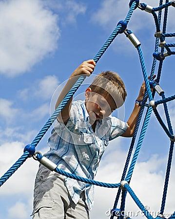 Kid Climbing Ropes