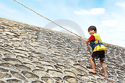 Kid climbing using rope