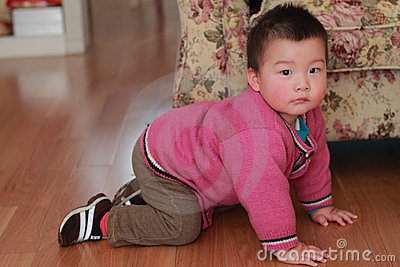 Kid crawling on the floor