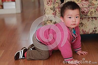 Kid crawling on the floor