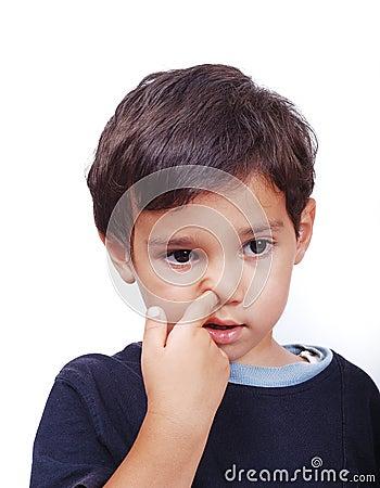 Kid diging his nose