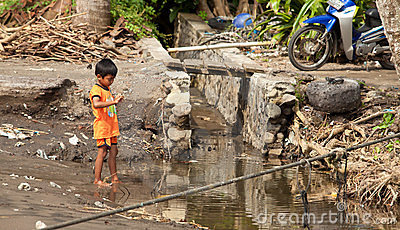 Kid in dirty water Editorial Stock Photo