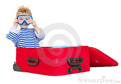 Kid with diving mask sail in suitcase