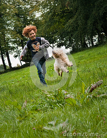 Kid and Dog running