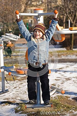 Kid doing fitness outdoor