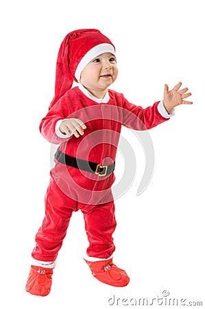 Kid dressed as Santa Claus.