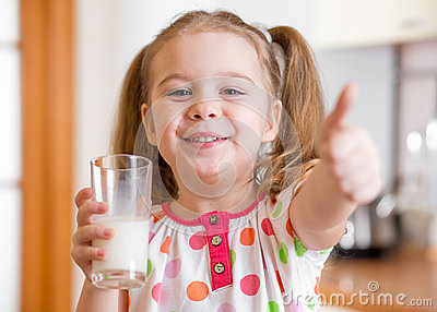 Kid drinking milk from glass