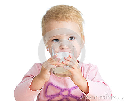 Kid drinking yoghurt from glass