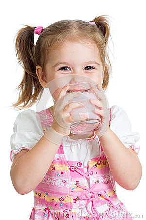 Kid drinking yoghurt from glass isolated